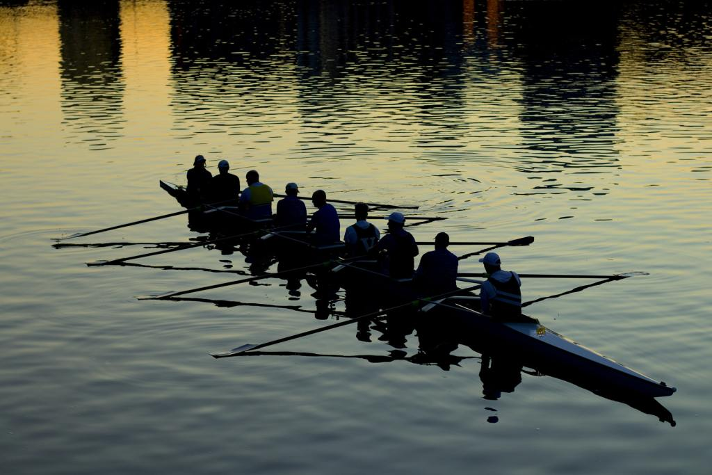 rowing team taking a quick break at sunset
